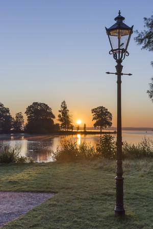 Germany, Mecklenburg-Vorpommern, Schwerin, sunrise at Lake Schwerin seen from Burggarten