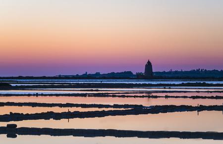 Italy, Sicily, Laguna dello Stagnone, Marsala, Saline Ettore Infersa windmill at sunset