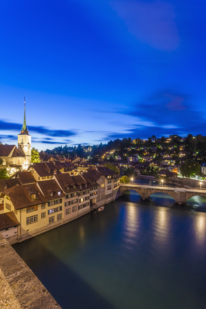 Switzerland, Bern, cityscape with Untertorbruecke, Nydeggkirche and River Aare in the evening