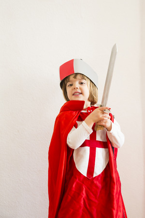 Portrait of little girl masquerade as a knight LANG_EVOIMAGES