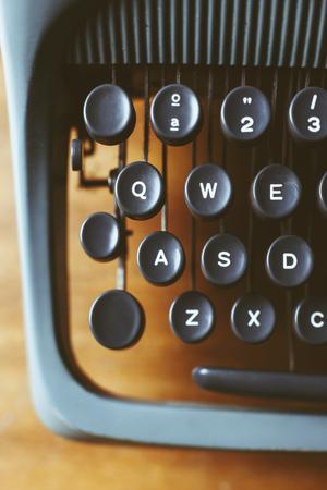 Old typewriter on wood, close-up