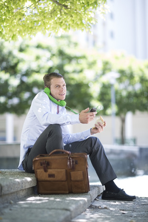 South Africa, Capetown, Businessman on the phone, outdoors