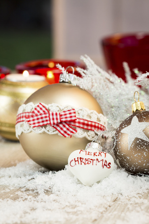 Different Christmas baubles and artifical snow