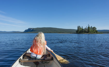 Sweden, Lapland, Norrbotten County, Kvikkjokk, canoeing girl on lake Saggat