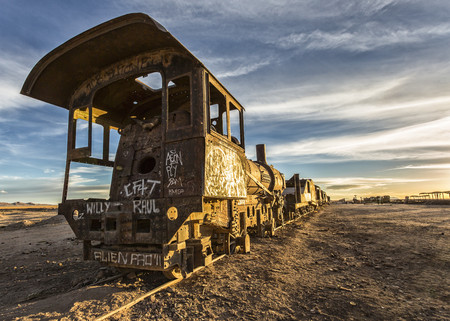 Bolivia, Atacama Desert, Uyuini, view to wreck of steam enginge at train cemetery