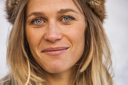 Portrait of smiling blond wearing fur cap