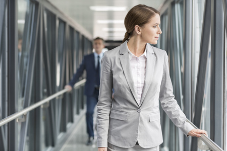 Businesswoman and businessman on jet bridge at the airport