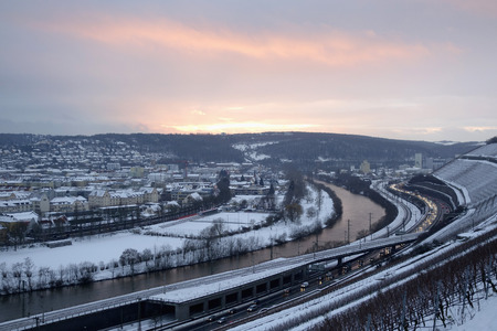 Germany, Wuerzburg, vineyard and traffic at River Main in winter