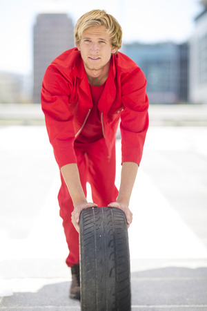 Portrait of car mechanic dressed in red