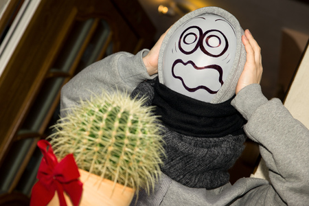 Balloon person horrified because of cactus