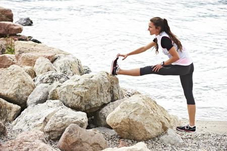 Italy, Trentino, jogger stretching at Lake Garda LANG_EVOIMAGES