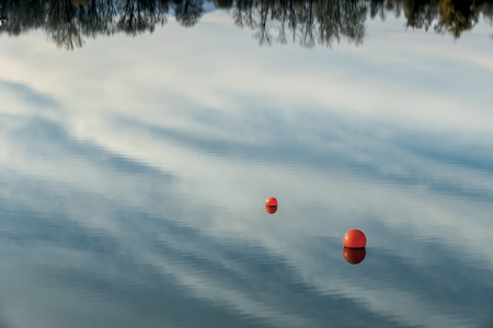Water reflection and buoys on a lake LANG_EVOIMAGES