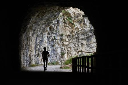 Italy, Trentino, woman running in tunnel near Lake Garda