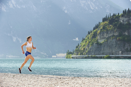 Italy, Trentino, woman running near at Garda