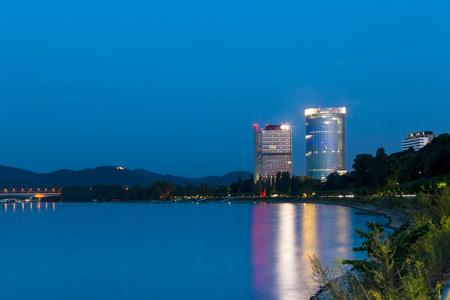 Germany, Bonn, view to Post Tower and UN Campus at blue hour