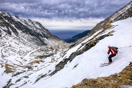 Romania, Southern Carpathians, Fagaras Mountains, skier in winter landscape LANG_EVOIMAGES
