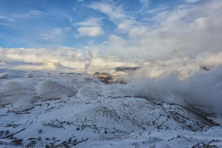 Italy, Abruzzo, Gran Sasso e Monti della Laga National Park, the town of Castel del Monte in winter LANG_EVOIMAGES
