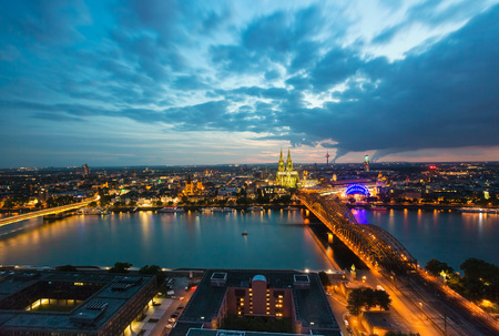 Germany, Cologne, view to lighted cityscape from above