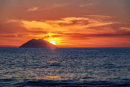 Italy, Sicily, Aeolian Islands, View to Isola Stromboli at sunset LANG_EVOIMAGES