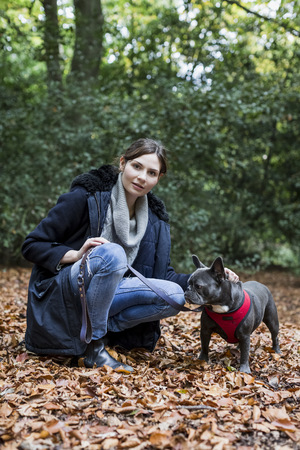 Portrait of woman with her dog in nature