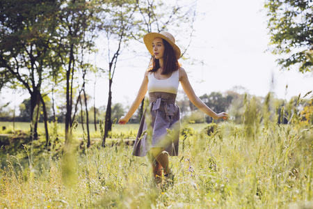 Young woman dancing on a meadow in spring LANG_EVOIMAGES