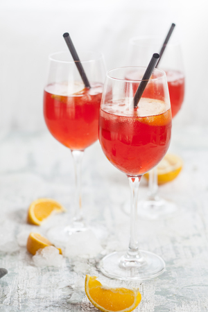 Aperol spritz, bitter liqueur, prosecco wine, sparkling mineral water and orange slice LANG_EVOIMAGES
