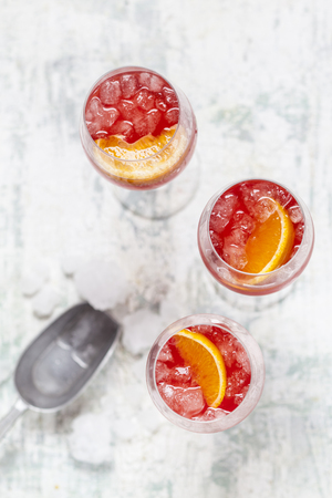 Aperol spritz, bitter liqueur, prosecco wine, sparkling mineral water and orange slice LANG_EVOIMAGES