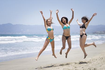 Mexico, Nuevo Vallarta, three friends having fun at the beach