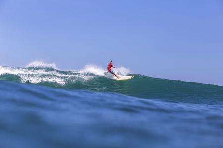 Indonesia, Bali, Surfer on wave LANG_EVOIMAGES
