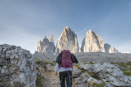 Italy, Alto Adige, Dolomites, female hiker in front of Tre Cime di Lavaredo