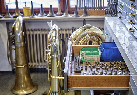 Workshop of an instrument maker with brass instruments