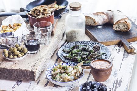 Grilled sepia, olives, pimientos de padron, Mojo sauce, patatas bravas, tortilla de patate, boquerones fritos, vino and bread LANG_EVOIMAGES