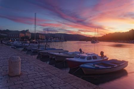 Croatia, Hvar Island, Stari Grad, Boats anchoring in the evening