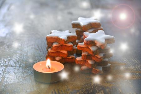 Stacks of cinnamon stars and tea light