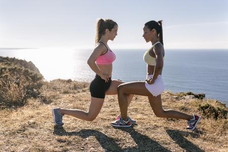 Spain, Asturias, two sportswomen training on the coast