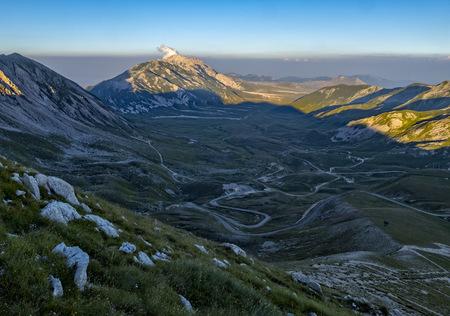 Italy, Abruzzo, Gran Sasso e Monti della Laga National Park, Mt Camicia and plateau Campo Imperatore at sunset LANG_EVOIMAGES