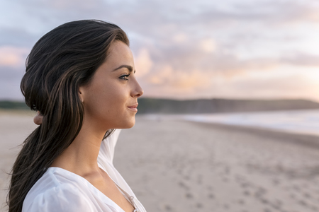 Spain, Asturias, beautiful young woman on the beach LANG_EVOIMAGES