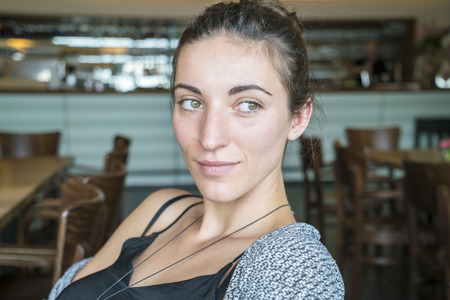 Portrait of woman in a coffee shop