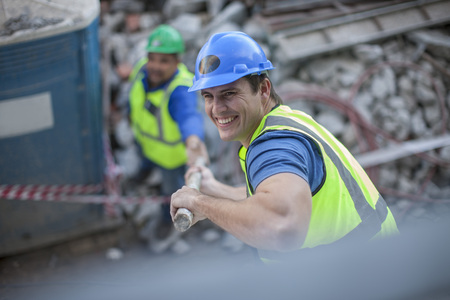 Smiling construction worker on construction site LANG_EVOIMAGES