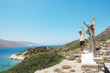 Greece, Nikouria, tourist looking to Amorgos in the distance