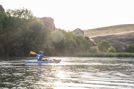 Spain, Segovia, Man in a canoe in Las Hoces del Rio Duraton LANG_EVOIMAGES