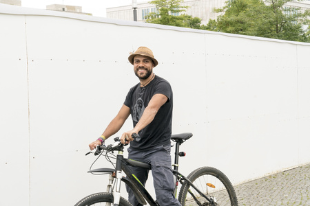 Portrait of smiling man on bicycle