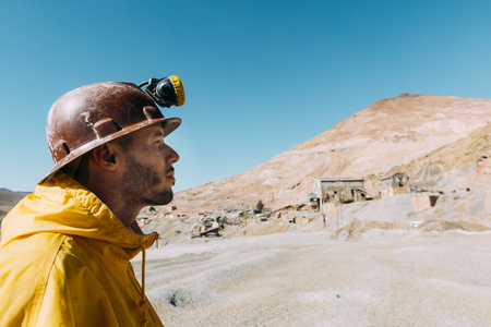 Bolivia, Potosi, tourist wearing protective clothing in front of the Cerro Rico silver mine