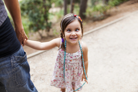 Portrait of little girl pulling funny faces LANG_EVOIMAGES