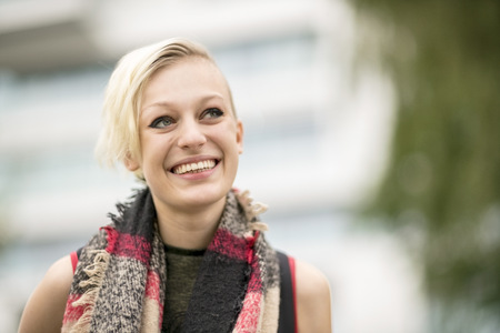 Portrait of smiling blonde woman with scarf LANG_EVOIMAGES
