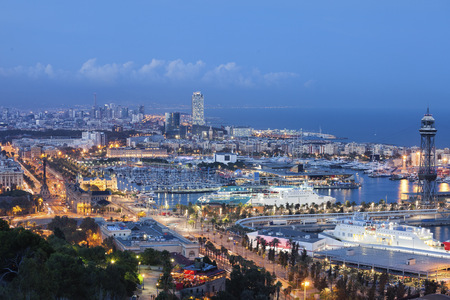 Spain, Barcelona, view to the lighted city at twilight