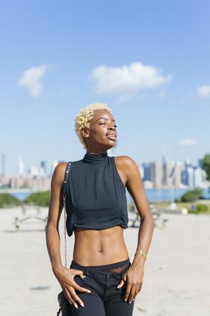 USA, New York City, Brooklyn, young woman enjoying the sunshine