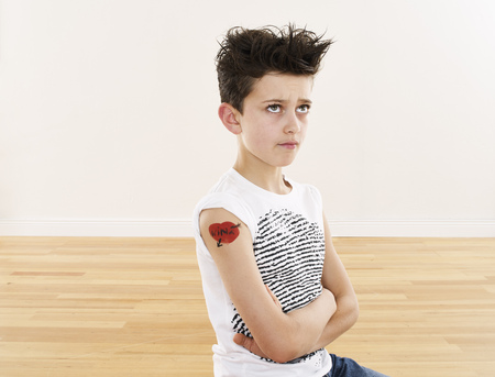 Cool boy with tattoo on his arm
