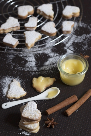 christmas cookies filled with lemon curd stock photo 94697459
