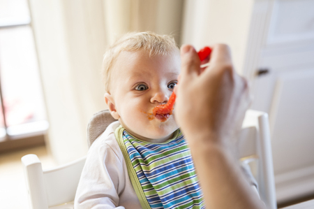 Baby boy being fed